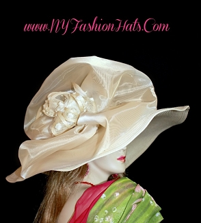 Ladies Ivory Wide Brim Hat With A Champagne Bow And Straw Flowers