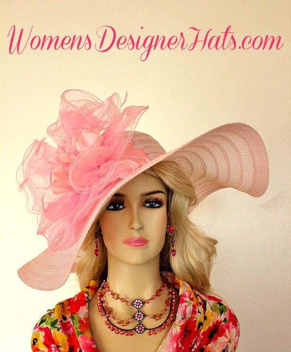 2bf493901808c Ladies Pink Wide Brim Kentucky Derby Hat With A Large Bow And Silk Flowers.  We Specialize In Ladies Pink Fashion Hats