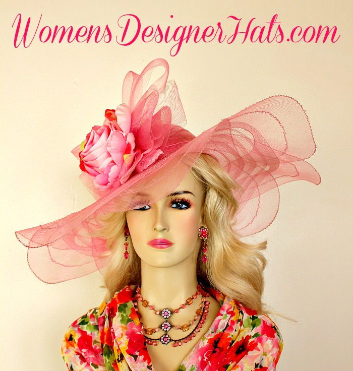 1afb97df4efae Ladies Pink Wide Brim Kentucky Derby Hat With A Large Bow And Silk Flowers  And A Pink Large Satin Rosette. We Specialize In Ladies Pink Fashion Hats
