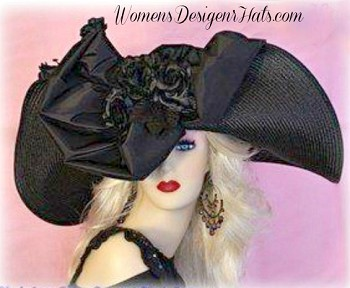 Black Wide Lift-Up Brim Haute Couture Designer Kentucky Derby Fashion Hat For Women With Black Roses. This Designer Dress Hat Is Trimmed With A Black Fabric Bow, Enhanced With Custom Made Silk Millinery Roses. This Versatile Hat Can Be Worn In Different Positions. This Feminine Hat Has Such A Romantic Feel. Customize This Designer Hat With Your Choice Of Custom Hat Colors, Bow Colors, And Custom Rose Colors. Hat Colors Include: Black, Ivory, Light Turquoise Blue, Charcoal Grey, Hot Raspberry Pink, Taupe Grewish Brown, Royal Navy Blue, Antique Gold, This Exquisite Southern Belle Hat, Is Custom Made And Designed By WomensDesignerHats.com. We Specialize In Formal Hats For Women, Custom Hats For Women, High Fashion Hats, Haute Couture Hats, Wedding Hats, Kentucky Derby Hat, Ladies Dress Hats, Church Hats, And Special Occasion Hats.