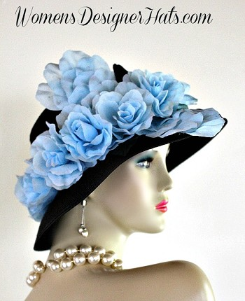 "Black Lampshade Kentucky Derby Designer Hat For Women With Baby Blue Roses. This Hand Made Fashion Hat Is Trimmed With Baby Blue Silk Millinery Rose That Wrap Around The Entire Crown Of This Couture Hat. New Condition - Custom Made. Measurements: 22.5"" Inner Crown. This Designer Custom Made Hat Is A Show Stopper. This Dress Hat Is Suited For Horse Races, The Kentucky Derby, Belmont Stakes, Preakness Stakes, Melbourne Cup, Royal Ascot, Church, Weddings, Tea Parties, Formals, And Special Occasions. Custom Made And Designed By Women's Designer Hats, www.womensdesignerhats.com"