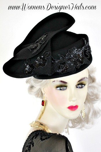 Black Custom Made Pillbox Shaped Winter Wool Designer Fashion Hat For Women. This Dress Hat Is Trimmed With Black Beaded Pearl Sequin Floral Appliques. This Church Hat Is Custom Made And Designed By WomensDesignerHats.com. We Specialize In Designer Hats For Women, Hats For Weddings, Cocktail Hats, Kentucky Derby Hats And Special Occasion Hats.
