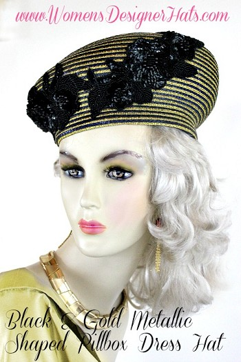 Women's Metallic Gold And Black Shaped Designer Pillbox Art Deco Styled Cocktail Hat. This Women's Hat Is Suited For Cocktail Parties, Weddings, Holidays, Formals And Special Occasions. Custom Made And Designed By www.WomensDesignerHats.com