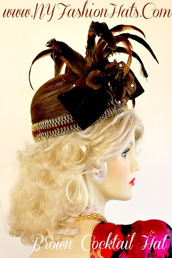Ladies Brown And Gold Wedding Fascinator Cocktail Hat, With A Brown Velvet Bow, Rhinestones, A Rose, And Feathers.  This Dress Hat, Is Suited For Parties, Flapper Roaring 20's Events, Holidays, Church, A Wedding, And Special Occasion.  Custom Made And Designed By www.NYFashionHats.Com