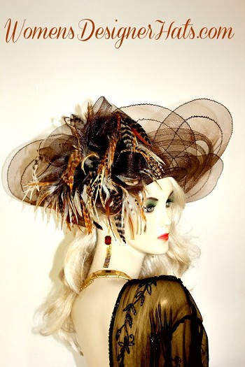 Ladies Brown Sheer Scallop Lift Up Brim Designer Fashion Hat For The Kentucky Derby And Special Occasion. This Custom Designed Women's Dress Hat Is Trimmed With Multi Colored Brown, Ivory, Golden Brown, Burnt Orange, Copper Brown, And Dark Chocolate Brown, Striped Tiger Feathers. Choose From A Large Array Of Custom Hat  Color Choices.  This Hat Can Be Completely Customized To Mach Your Wardrobe. Hat Colors Include: Black Hats, Ivory Hats, Vanilla Ivory Hats, Navy Blue Hats, Purple Hats, Red Hats, White Hats, Dark Chocolate Brown Hats, Soft Pink Hats, Orange Hats, Turquoise Blue Hats, Yellow Hats, Kelly Green Hats, And Lavender Or Light Purple Hats. NOTE: Feathers on all hats will be as pictured, bowing will be the hat color.  This Women's Hat Is Suited For Parties, Weddings, Holidays, Formals, The Kentucky Derby, The Kentucky Oaks Race, The Belmont Stakes, The Preakness, Saratoga, The Royal Ascot, Horse Races, And Special Occasions. This Church Hat Is Custom Made And Designed By WomensDesignerHats.com.