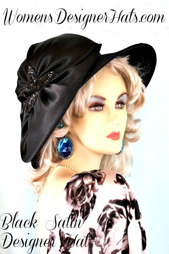 Ladies Black Satin Designer Fashion Dress Hat. This elegant dress hat is suited for Thoroughbred horse racing track events, steeplechase racing, harness racing, the Kentucky Derby, the Belmont Stakes, the Preakness, the Royal Ascot, Del Mar Race Track, Santa Anita Park, Virginia Gold Cup, Saratoga NY Racetrack, casino shows, formal affairs, garden tea parties, mother of the bride or groom, dress up events, Church, funerals, Easter Sunday, weddings, and formals. This Kentucky Derby hat is custom made and designed by www.womensdesignerhats.com. This Elegant Hat Is Available In Navy Blue, Brown, Hot Pink, And Purple