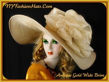 Women's Custom Made Antique Gold Straw Braid Designer Kentucky Derby Dress Hat Embellished With A Large Antique Gold Organza Bow Accented With Metallic Gold Swirls And Dots. This Elegant Ladies Formal Hat Is Suited For Horse Races, The Kentucky Derby, Wedding, Church, Bridal Luncheons, Bridal Showers, Mother Of The Bride, Formals And Special Occasions. This Fashion Hat Is Custom Made And Designed By NY Fashion Hats Haute Couture Millinery. http://www.nyfashionhats.com