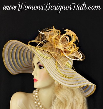 White And Metallic Gold Haute Couture Designer Fashion Hat For Women. This Designer Dress Hat Is Trimmed With A Large Sinamay Straw Flower Petal Bow, Adorned With Expensive Gold And White Feathers. Behind The Bow Is Placed Gold Netting And Metallic Gold Adornments For Added Design. This Exquisite Hat, Is Custom Made And Designed By WomensDesignerHats.com. We Specialize In Formal Hats For Women, Custom Hats For Women, High Fashion Hats, Wedding Hats, Kentucky Derby Hat, Ladies Dress Hats, Church Hats, And Special Occasion Hats.