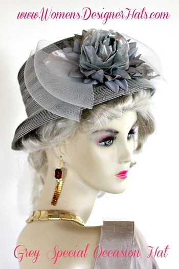 Women's Or Ladies Silver Grey Designer Fashion Hat With A Large Bow And Metallic Silver Flower.  We Specialize In Church Hats, Formal Hats For Women, Wedding Hats For Women, Woman's Fashion Hats, Ladies Holiday Hats And Special Occasion Hats. Custom Made And Designed By www.WomensDesignerHats.com