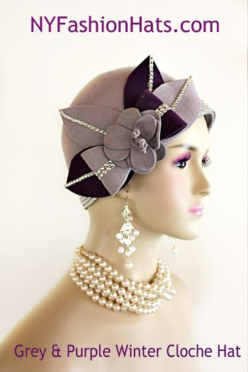 Women's Designer Haute Couture One Of A Kind Grey And Purple Winter Wool Cloche Art Deco 1920's Flapper Style Pillbox Hat. This Fashion Hat Is Trimmed With A Purple And Grey Wool Flower Accented With A Bow, Encased With A Double Row Of Acrylic Rhinestones. Four Large Wool Purple And Grey Leaves Are Adorned Around The Flower. These Leaves Contain A Single Row Of Rhinestones. Glamorous Clear Rhinestones Wrap Around The Crown Of This Stylish Ladies Church Hat. This Formal Winter Wool Dress Hat Is Suited For Winter And Fall Weddings, Church, Formals, Holidays, Horse Races And Special Occasions. This High Fashion Hat Or Headpiece Is Custom Made And Designed By NY Fashion Hats Millinery Headwear, http://www.nyfashionhats.com