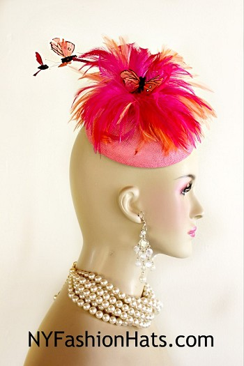 Women's Pink Sinamay Straw Feather Butterfly Fashion Designer Haute Couture Hat Headpiece Wedding Fascinator Hair Accessory. A Combination Of Hot Pink And Peach Hackle Rooster Feathers Are Placed In Circular Design On A Simulated Pink Sinamay Straw Round Base. Placed In The Center Of This Beautiful Circular Feather Flower Is A Feather Butterfly. Two Shooting Feather Butterflies On Wire That Appear To Be Flying In The Air Are Placed Within The Feathers. This Formal Art Deco Styled 1920's Style Flapper Hat Wedding Headpiece Can Be Worn In Different Positions.  This ladies bespoke couture formal designer wedding fascinator hat is appropriate to wear for horse races, The Kentucky Derby, The Dubai World Cup, The Royal Ascot, The Melbourne Cup, Belmont Stakes, The Preakness Stakes horse racing, Church, weddings, and special occasion. This lovely Spring and Summer fascinator is also suited for mother of the bride or a bride. This Unique Hat Will Make A Fashion Statement. This Special Occasion Hat Is Custom Made And Designed By NY Fashion Hats Millinery, http://www.nyfashionhats.com
