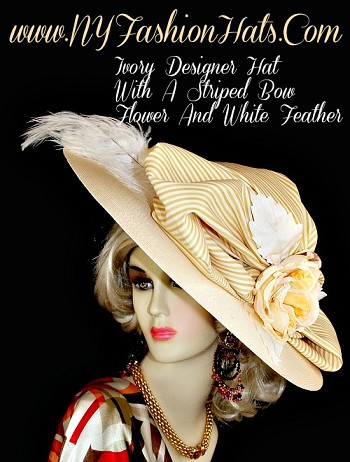 Kentucky Derby Hats, Ivory Wide Brim Designer Hat, With An Antique Gold And Ivory Striped Bow, A Custom Made Flower, With An Ivory Satin Rosette In The Center, Ivory Silk Leaves, And A Large White Ostrich Feather.  We Sell Church Hats, Designer Hats For Women, Kentucky Derby Hats, Dress Hats For Women, Ladies Formal Hats, Belmont Stakes Hats, Preakness Hats, Saratoga Horse Racing Hats, Hats For Weddings, Tea Party Hats, Holiday Hats, Easter Hats, And Special Occasion Hats.  Custom Made And Designed By NY Fashion Hats Millinery Women's Headwear Apparel, http://www.nyfashionhats.com