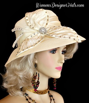 Ivory Wide Brim Designer Kentucky Derby Fashion Hat For Women. This Dress Hat Is Adorned With A Satin Bow, Enhanced With Rhinestones And Feathers. This Hat Can Match Any Women's Wardrobe Or Outfit. This Formal Hat Is Simple In Design, Yet So Feminine And Elegant. Women's Designer Hats, www.womensdesignerhats.com, Specialize In Designer Hats For Women, Hats For Weddings, Haute Couture Hats For Women, High Fashion Hats, Hats For Brides, Kentucky Derby Hats, Preakness Stakes Hats, Belmont Stakes Hats, Royal Ascot Hats, Hats For Horse Races, World-Class Thoroughbred Horse Racing Hats, Custom Harness Racing Hats For The Racetrack, Melbourne Cup Hats, Del Mar Race Track, Santa Anita Park, Virginia Gold Cup, Saratoga NY Racetrack, Hats For Casino Stage And Entertainment Shows, Hats For Formal Affairs.  Garden Tea Party Hats,  Mother Of The Bride Or Groom Hats, Hats For Dress-Up Events, Church Hats, Easter Sunday Hats, And Hats For Dress-Up Events.