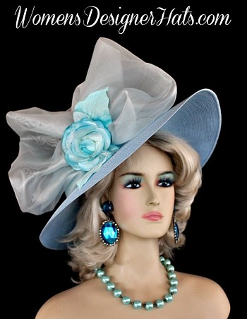 Ladies Baby Blue White Custom Made Straw Braid Designer Wide Brim Fashion Church Hat With A Baby Blue Rose. This Dress Hat Is Trimmed With A Large White Organza Bow, Accented With A Baby Blue Turquoise Silk Vintage Millinery Rose, Embellished With Silk Millinery Leaves Which Are Placed Within This Beautiful Bow. This Feminine Designer Hat Has A Romantic Flair. A Perfect Dress Hat For A Wedding Guest. This Women's Hat Is Suited For Weddings, Holidays, Church, Formals, Garden Tea Parties, The Kentucky Derby, The Melbourne Cup, The Royal Ascot, Spring Horse Races, And Special Occasions. This Church Hat Is Custom Made And Designed By Women's Designer Hats, www.womensdesignerhats.com