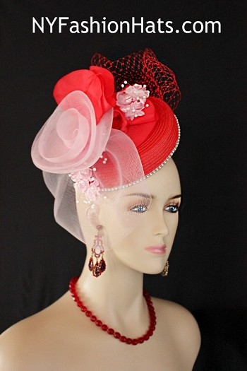 Women's Designer Red And Soft Pink Formal Straw Braid Special Occasion Wedding Fascinator Pillbox Style Cocktail Hat Bridal Headpiece. This Couture Red And Pink Church Hat Headpiece Is Embellished With A Large Pink Crinoline Horsehair Large Rose Bow, Accented With A Red Birdcage Netting Bow. Beautiful Hand Dyed Pink Iridescent Vintage Silk Millinery Flowers With White Pearls Are Placed Within The Bow, Enhanced With Red Vintage Silk Roses And Petals. A Single Row Of Acrylic Rhinestones Encircles The Crown Of This Fashion Wedding Headpiece. This Formal 1920's Flapper Art Deco Styled Hat Wedding Headpiece Can Be Worn In Different Positions.