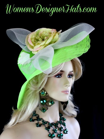 Ladies Lime Green Wide Scallop Brim Dress Hat For Weddings And The Kentucky Derby With A Silk Millinery Flower. This Versatile Designer Hat Can Be Worn With The Flower And Bowing Toward The Face Or Toward The Back Of The Wearers Head. This Fashion Hat Is Trimmed With A Large Ivory Crinoline Bow, Accented With A Large Silk Millinery Flower, Enhanced With Kelly Green And Ivory Vintage Millinery Leaves.  This Classic Designed Ladies Hat Is Custom Made And Designed By Women's Designer Hats, womensdesignerhats.com.