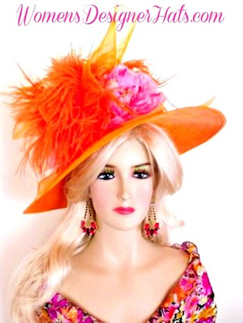 Orange Wide  And Pink Brim Kentucky Derby Hat For Women. This Hand Made Fashion Hat Is Trimmed With A Sheer Orange Crin Netting Bow, Adorned With Beautiful Orange Ostrich Feathers. A Pink Silk Millinery Flower, Give This Fashion Hat Such Versatile Styling. This Designer Custom Made Hat Is A Show Stopper. A Perfect Kentucky Derby Or Kentucky Oaks Horse Racing Hat. Custom Made And Designed By Women's Designer Hats, www.womensdesignerhats.com