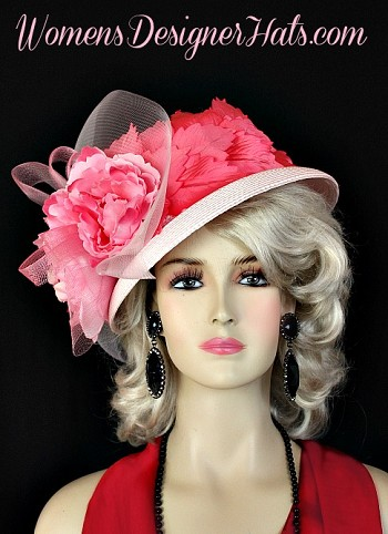 Ladies Pastel Pink Designer Dress Kentucky Derby Hat, Trimmed With A Large Sheer Crin Bow, Accented With Multi Colored Peony Flowers With A Satin Rosette Center. Beautiful Millinery Leaves In Hot Pink Are Placed On One Side Of The Crown. This Fashion Hat Is Suited For Wedding Guests, Spring Formals, Horse Racing Events, And Church. This Haute Couture Fashion Hat Is Custom Made And Designed By Women's Designer Hats, womensdesignerhats.com