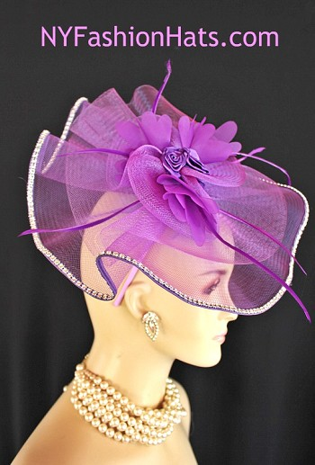 Women's Purple Satin Hairband Rhinestone Fashion Designer Haute Couture Hat Headpiece Wedding Fascinator. This Purple Horsehair Large Bow Wedding Fascinator Is Trimmed With Purple Organza Flowers Enhanced With Handmade Purple Satin Rosettes. Placed Along The Outside Edge Of This Beautiful Headpiece Are Acrylic Rhinestones. Delicate Purple Goose Biot Feathers Are Placed Within The Bowing For Added Design.This ladies bespoke formal hat is appropriate to wear for horse races, The Kentucky Derby, The Dubai World Cup, The Royal Ascot, The Melbourne Cup, Belmont Stakes, The Preakness Stakes horse racing, Red Hat Society Events, Church, weddings, and special occasion. This lovely Spring and Summer fascinator is also suited for mother of the bride or a bride. This Unique Hat Will Make A Fashion Statement. This Special Occasion Hat Is Custom Made And Designed By NY Fashion Hats Millinery, www.nyfashionhats.com