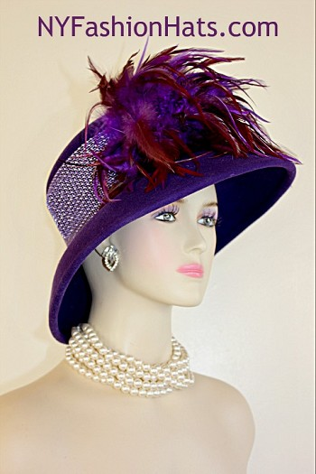 Women's Designer Haute Couture Purple Winter Wool Wide Brimmed Fashion Hat Trimmed With Expensive Purple And Burgundy Rooster Feathers. Glamorous Rhinestones Wrap Around The Crown Of This Stylish Ladies Church Hat. This Formal Winter Wool Dress Hat Is Suited For Winter And Fall Weddings, Church, Formals, Holidays, Horse Races And Special Occasions. This High Fashion Hat Or Headpiece Is Custom Made And Designed By NY Fashion Hats Millinery Headwear, http://www.nyfashionhats.com