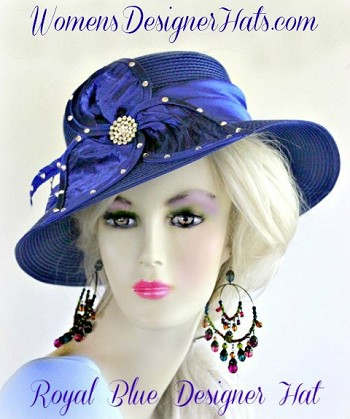 Royal Blue Wide Brim Designer Kentucky Derby Fashion Hat For Women. This Dress Hat Is Adorned With A Satin Bow, Enhanced With Rhinestones And Feathers. This Hat Can Match Any Women's Wardrobe Or Outfit. This Formal Hat Is Simple In Design, Yet So Feminine And Elegant. Women's Designer Hats, www.womensdesignerhats.com, Specialize In Designer Hats For Women, Hats For Weddings, Haute Couture Hats For Women, High Fashion Hats, Hats For Brides, Kentucky Derby Hats, Preakness Stakes Hats, Belmont Stakes Hats, Royal Ascot Hats, Hats For Horse Races, World-Class Thoroughbred Horse Racing Hats, Custom Harness Racing Hats For The Racetrack, Melbourne Cup Hats, Del Mar Race Track, Santa Anita Park, Virginia Gold Cup, Saratoga NY Racetrack, Hats For Casino Stage And Entertainment Shows, Hats For Formal Affairs.  Garden Tea Party Hats,  Mother Of The Bride Or Groom Hats, Hats For Dress-Up Events, Church Hats, Easter Sunday Hats, And Hats For Dress-Up Events.