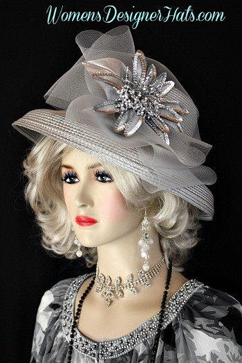 Silver Grey Formal Special Occasion Dress Hat For Women. This Hand Made Designer Hat Is Trimmed With A Sheer Crin Grey Bow, Accented With A Large Hand Painted Metallic Silver Sequin Flower. A Metallic Silver Leaf Is Placed Behind The Flower For Added Design. A Lovely Hat For A Wedding Guest, Bridesmaid, Or For The Kentucky Derby. Custom Made And Designed By Women's Designer Hats, womensdesignerhats.com