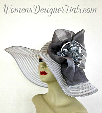 White And Metallic Silver Haute Couture Designer Fashion Hat For Women. This Kentucky Derby Dress Hat Is Trimmed With A Large Grey Fabric Bow, Accented With A Hand Dyed Metallic Silver Flower, Embellished With Delicate White Feathers. This Exquisite Hat, Is Custom Made And Designed By Women's Designer Hats, www.womensdesignerhats.com. We Specialize In Formal Hats For Women, Custom Hats For Women, High Fashion Hats, Wedding Hats, Kentucky Derby Hat, Ladies Dress Hats, Church Hats, And Special Occasion Hats.