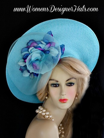 Ladies Turquoise Blue  Haute Couture Designer Fashion Hat With A Lift Up Brim. This Designer Dress Hat Is Trimmed With A Large Turquoise Blue Crin Rosette Bow, Adorned With Multi Colored Flower Petals Containing Purple, Aqua, And Royal Blue. Turquoise Blue Pecks Are Placed Within The Custom Made Flowers. The Same Flowers Are Placed On The Back Of This Wide Brim Hat. This Exquisite Hat, Is Custom Made And Designed By WomensDesignerHats.com. We Specialize In Formal Hats For Women, Wedding Hats, Hats For Holidays, Kentucky Derby Hat, And Special Occasion Hats.