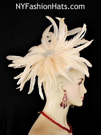 Women's Ivory Rhinestone Straw Braid Fashion Designer Haute Couture Shaped Cocktail Hat Feathered Headpiece Wedding Bridal Fascinator Hair Accessory. This Couture Custom Made Kentucky Derby Hat Is Embellished With Exotic Ivory Long Rooster Coque Feathers. Placed In The Center Of This Handmade Feather Flower Are Acrylic Clear Rhinestones. A Double Row Of Acrylic Rhinestones Encircle The Base Of This Shaped Fascinator Headpiece. This Formal Art Deco Styled 1920's Style Flapper Hat Wedding Headpiece Can Be Worn In Different Positions. This Wedding Pillbox Hat Will Make A Fashion Statement.  This ladies bespoke couture formal designer wedding fascinator hat is appropriate to wear for horse races, The Kentucky Derby, The Dubai World Cup, The Royal Ascot, The Melbourne Cup, Belmont Stakes, The Preakness Stakes horse racing, Church, weddings, and special occasion. This lovely Spring and Summer fascinator is also suited for mother of the bride or a bride. This Unique Hat Will Make A Fashion Statement. This Special Occasion Hat Is Custom Made And Designed By NY Fashion Hats Millinery, http://www.nyfashionhats.com