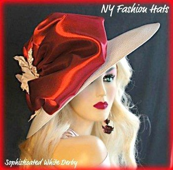 White Wide Brim, Ladies Designer Hat, With A Burgundy Satin Bow, White Silk Rose, And A Long Burgundy Ostrich Feather, By www.NYFashionHats.Com.  This Formal Fashion Hat, Is Suited For A Wedding, Church, Horse Racing, Carriage Driving, And Special Occasion.