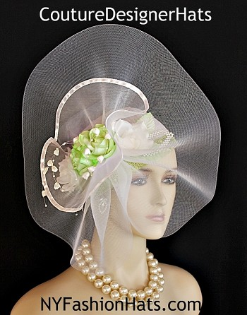 Ladies Art Deco 1920's Styled Custom Made White And Lime Green Designer Cocktail Pillbox Wedding Church Hat Headpiece. This sheer haute couture hat can be worn with the bow toward the front of the face, or to the back of the head.  This dressy white and lime green haute handmade headpiece is embellished with a large sheer white horse hair crinoline bow enhanced with a large organza bow trimmed in white satin edging. Placed within this elaborate bowing are vintage lime green and white roses. Beautiful hanging lily of the valley flowers accented with white pearls gives this dress hat such a feminine touch. Handmade pearl and silk leaves are placed along side the roses. Lime Green Sequin Is Placed Around The Bottom Portion Of The Crown.  A perfect hat for Mother Of The Bride Or Groom, bridesmaids, brides, formals, and special occasion.  Match one of your formal dresses, suits, gowns, or wardrobe to this gorgeous custom made cocktail hat by www.NYFashionHats.Com