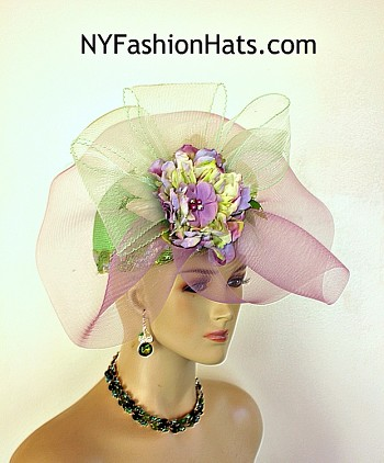 Women's Custom Lime Green Purple Lavender Statement Designer Church Wedding Pillbox Round Crown Shaped Hat. This Hand Made High Fashion Lime Green Pillbox Hat Is Trimmed With A Large Mint Or Soft Lime Green And Lavender Purple Crinoline Horsehair Bow. Placed Within This Dramatic Bowing Is A Handmade Vintage Silk Flower Containing Multiple Shades Of Lime White Purple And Lavender. An Organza Flower Containing Purple Pearls And Rhinestones Is Placed In The Center Of This Gorgeous Flower. Shaped Vintage Lime Green And White Flower Petals Are Placed Behind The Bow As Well As Vintage Lime Green Leaves Containing Rhinestones. This Formal Wedding Kentucky Derby Hat Will Made A Feminine Fashion Statement. The Bowing Can Be Worn In The Front Of The The Face Or Toward The Back Of The Head. This Versatile Dress Hat Is Custom Made And Designed By NY Fashion Hats Couture Millinery, https://www.nyfashionhats.com