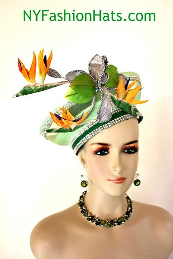 Women's Elegant Lime And Kelly Green Statement Pillbox Designer Church Wedding Cocktail Hat Headpiece. This Hand Made High Fashion Hat Is Trimmed With A Large Hand Painted Metallic Silver Vintage Large Flower Containing Pearls And Vintage Lime Green Leaves. Placed Around This Ornate Flower Are Rare Vintage Bird Of Paradise Flowers In A Beautiful Orange Yellow And Purple Color. These Flowers Are Handmade During The Vintage Era. Rhinestones Wrap Around The Outside Brim And Crown Of This Glamorous Hat. This Formal Wedding Kentucky Derby Hat Will Made A Feminine Fashion Statement. This Headpiece Can Be Worn In Different Positions. Flowers Can Be Worn Toward The Front Or Back Of The Head. This Versatile Dress Hat Is Custom Made And Designed By NY Fashion Hats Couture Millinery, https://www.nyfashionhats.com  Hats For Woman  - NY Fashion Hats Specializes In Designer Hats For Women, Hats For Weddings, Bridal Headpieces And Hats, Wedding Fascinators, Art Deco Inspired Flapper Hats, Flapper 1920's Inspired Hats, Cocktail Hats, Hats For Formals, Kentucky Derby Hats, Melbourne Cup Hats, Royal Ascot Hats, Hats For Horse Races, Easter Hats, Mother's Day Hats, And Special Occasion Hats.